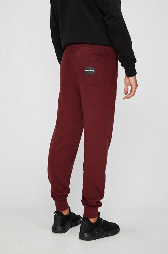 Calvin Klein Jeans - Kalhoty Hlavní materiál: 100% Bavlna Jiné materiály: 97% Bavlna, 3% Elastan