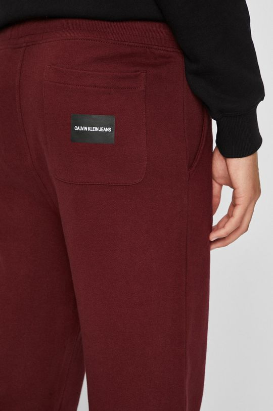 kaštanová Calvin Klein Jeans - Kalhoty