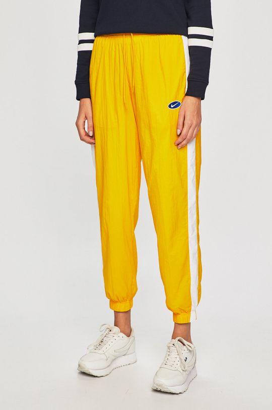 žlutá Nike Sportswear - Kalhoty Dámský