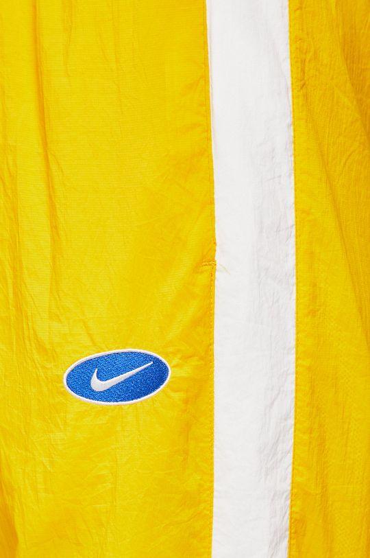 žlutá Nike Sportswear - Kalhoty
