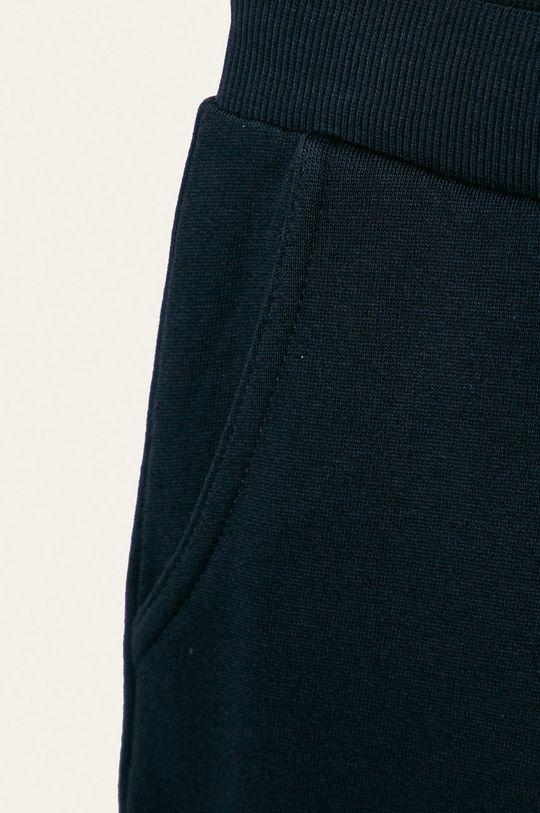 Guess Jeans - Dětské kalhoty 118-175 cm námořnická modř