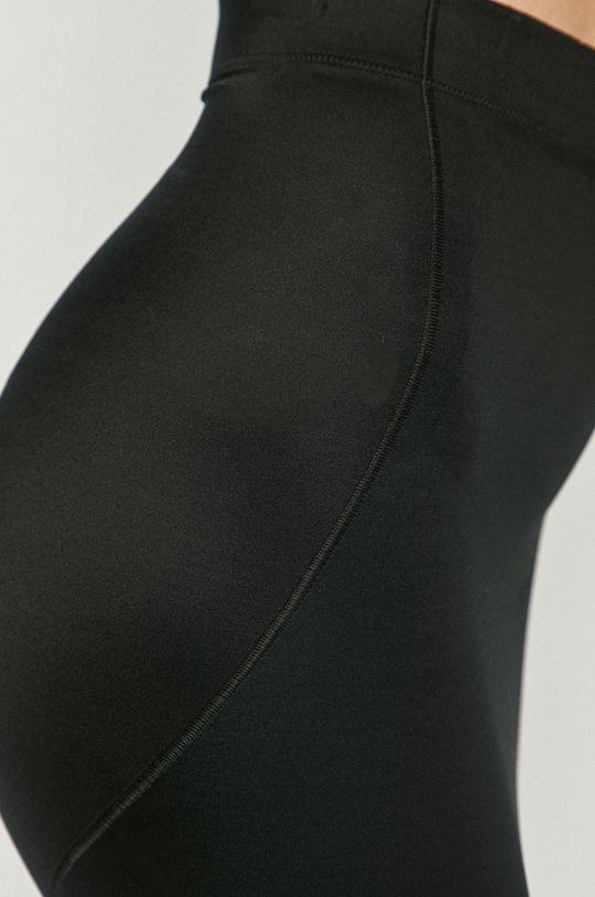 Spanx - Tvarujúca sukňa No-slip  Podšívka: 20% Elastan, 80% Nylón Základná látka: 42% Elastan, 58% Nylón