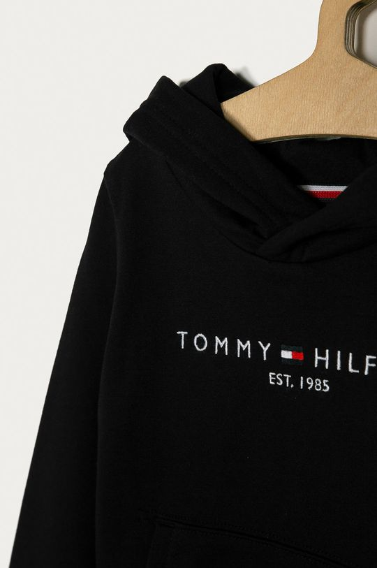 Tommy Hilfiger - Bluza copii 98-176 cm  Materialul de baza: 65% Bumbac, 5% Elastan, 30% Poliester  Captuseala glugii: 60% Bumbac, 40% Poliester  Banda elastica: 59% Bumbac, 2% Elastan, 39% Poliester