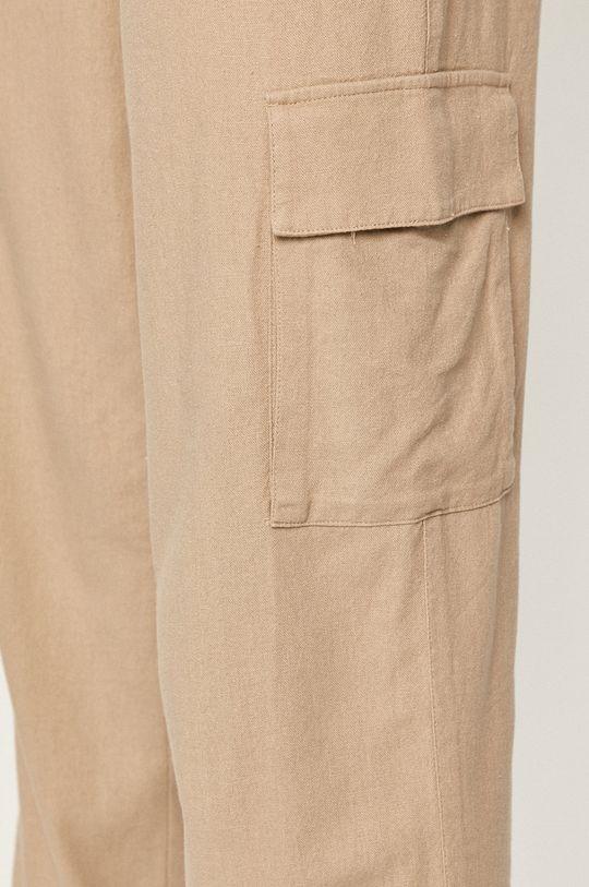 beżowy Tommy Jeans - Spodnie