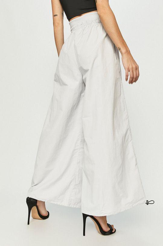 Reebok - Kalhoty  Hlavní materiál: 100% Nylon Jiné materiály: 7% Elastan, 93% Polyester