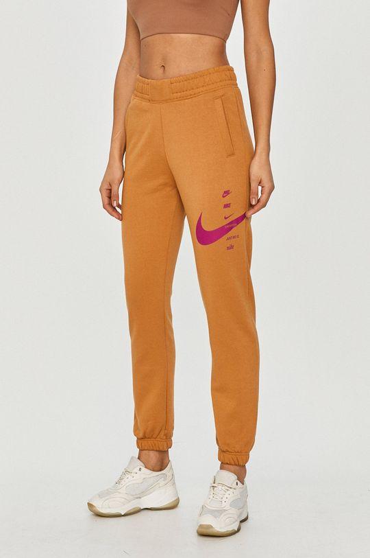brzoskwiniowy Nike Sportswear - Spodnie Damski