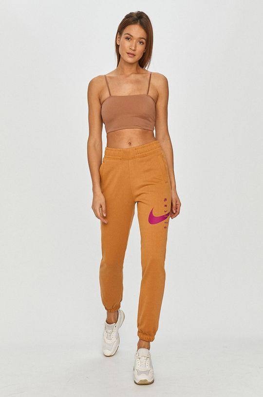 Nike Sportswear - Spodnie brzoskwiniowy