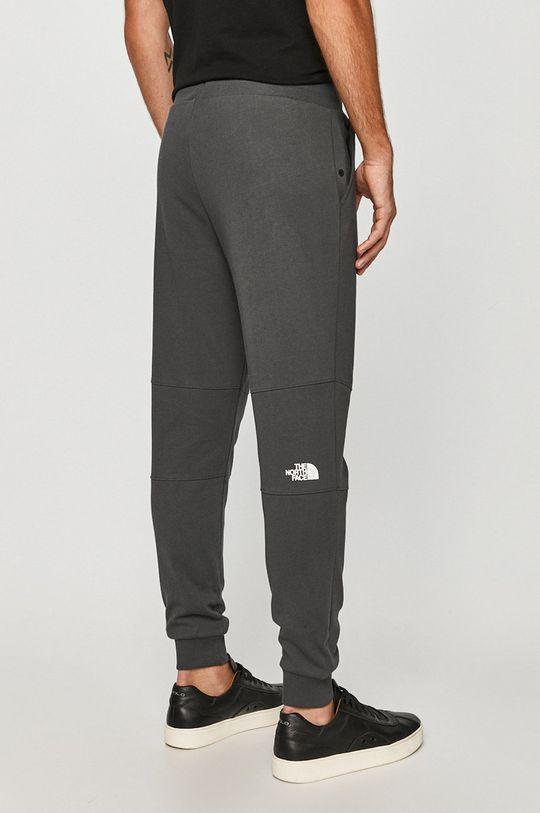 The North Face - Kalhoty  Hlavní materiál: 100% Bavlna Provedení: 100% Polyester Stahovák: 96% Bavlna, 4% Elastan