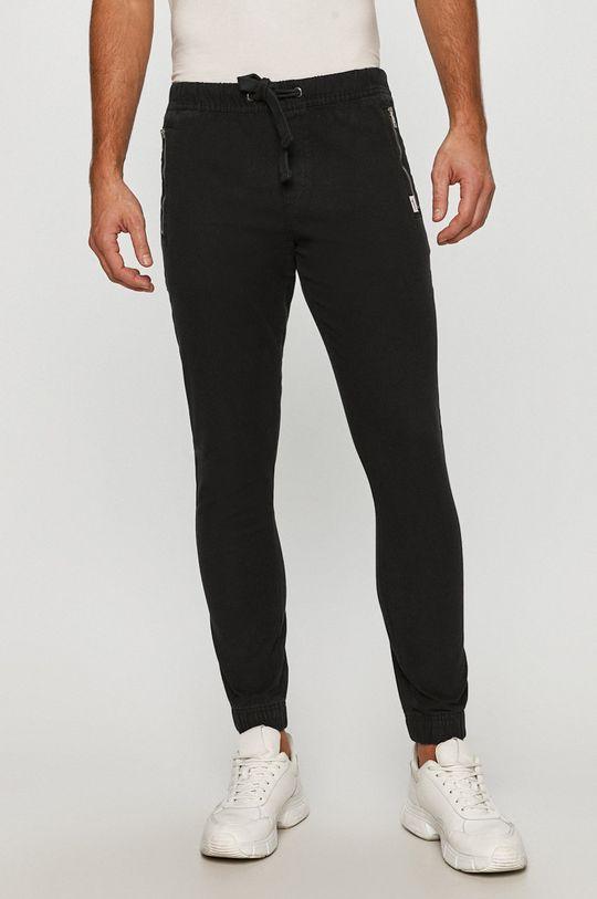czarny Tommy Jeans - Spodnie Męski