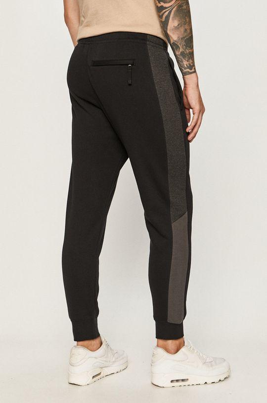 Nike Sportswear - Pantaloni  Materialul de baza: 80% Bumbac, 20% Poliester  Captuseala buzunarului: 100% Bumbac