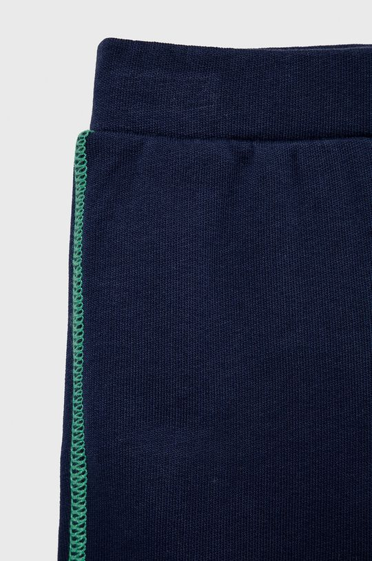 United Colors of Benetton - Detská tepláková súprava  1. látka: 100% Bavlna 2. látka: 100% Bavlna Elastická manžeta: 95% Bavlna, 5% Elastan