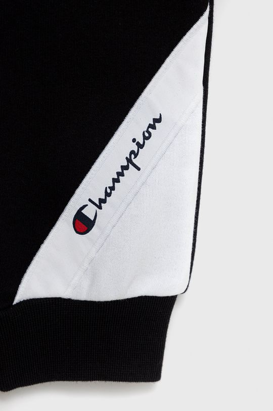 Champion - Pantaloni copii  Materialul de baza: 79% Bumbac, 21% Poliester  Finisaj: 100% Bumbac Banda elastica: 98% Bumbac, 2% Elastan