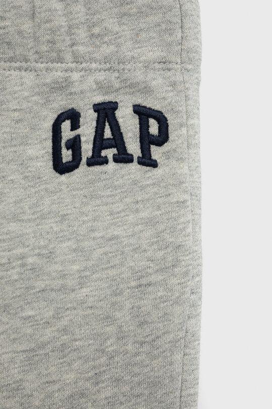GAP - Spodnie niemowlęce 77 % Bawełna, 14 % Poliester, 9 % Poliester z recyklingu