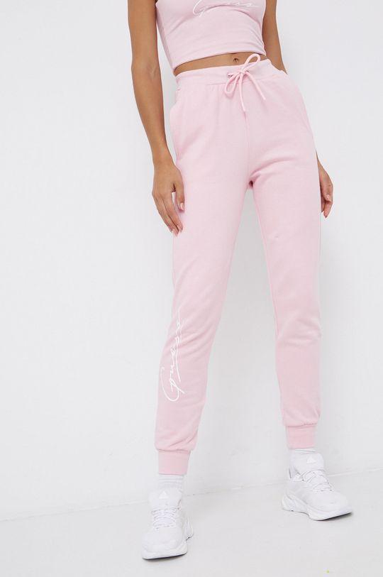 różowy Guess - Spodnie bawełniane Damski