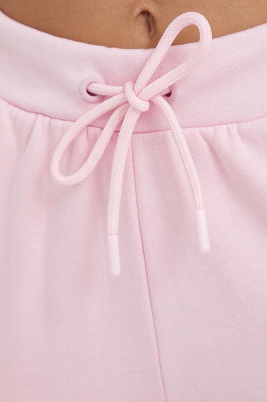 różowy Guess - Spodnie bawełniane