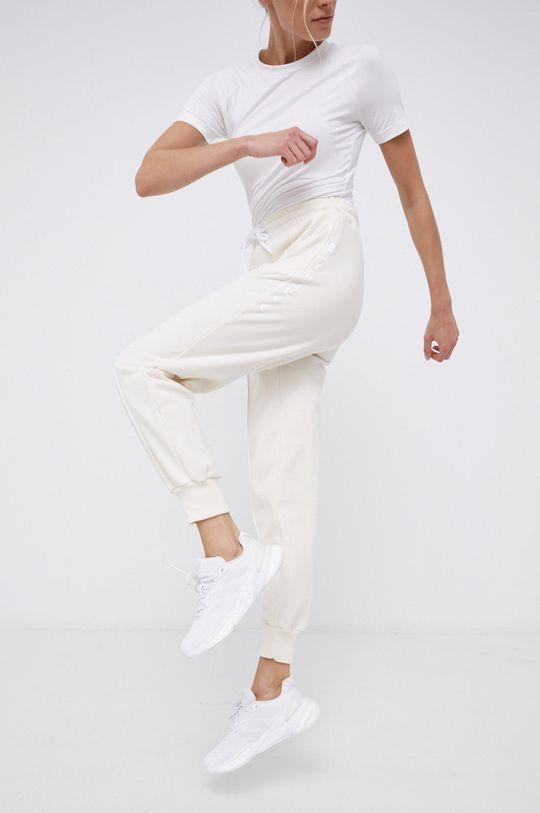 kremowy adidas Performance - Spodnie x Karlie Kloss Damski