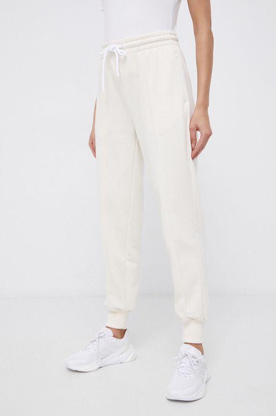 kremowy adidas Performance - Spodnie x Karlie Kloss
