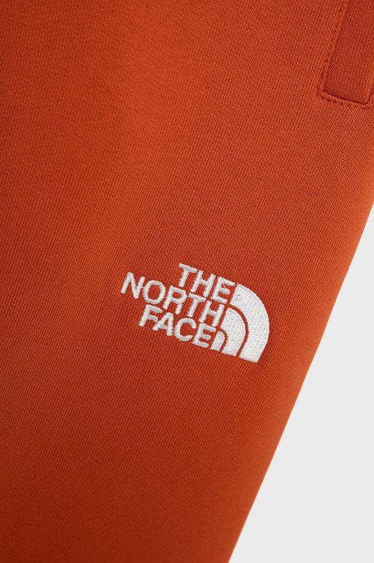 The North Face - Spodnie bawełniane dziecięce pomarańczowy
