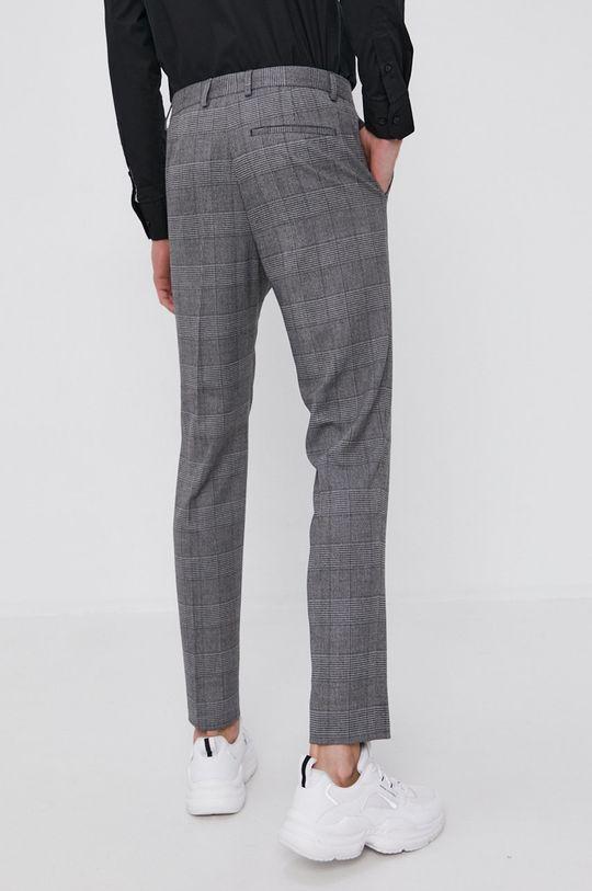 Calvin Klein - Kalhoty  Hlavní materiál: 2% Elastan, 64% Polyester, 34% Viskóza Podšívka kapsy: 35% Bavlna, 65% Polyester