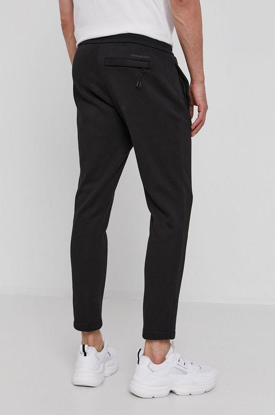 Calvin Klein Jeans - Spodnie 73 % Bawełna, 27 % Poliester