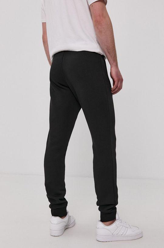 adidas Originals - Kalhoty  Hlavní materiál: 70% Bavlna, 30% Polyester Podšívka kapsy: 100% Bavlna Stahovák: 95% Bavlna, 5% Elastan