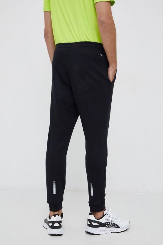 Calvin Klein Performance - Pantaloni  Materialul de baza: 87% Bumbac, 13% Poliester  Captuseala buzunarului: 100% Bumbac Finisaj: 97% Bumbac, 3% Elastan