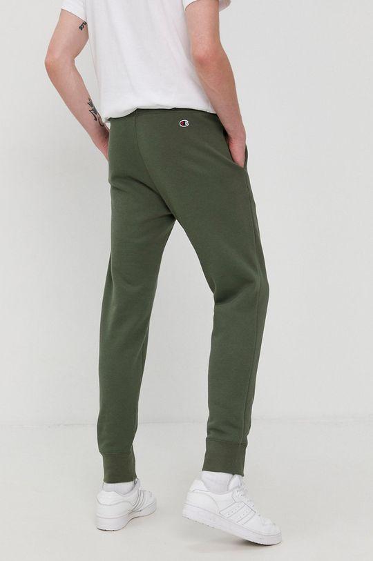 Champion - Pantaloni  Materialul de baza: 73% Bumbac, 27% Poliester  Alte materiale: 100% Bumbac Banda elastica: 98% Bumbac, 2% Elastan