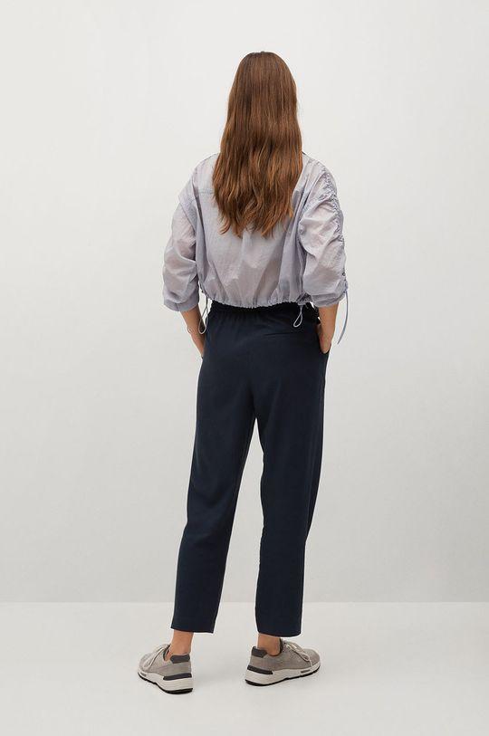 Mango - Kalhoty FLUIDO  Hlavní materiál: 20% Lyocell, 80% Viskóza Podšívka kapsy: 35% Bavlna, 65% Polyester