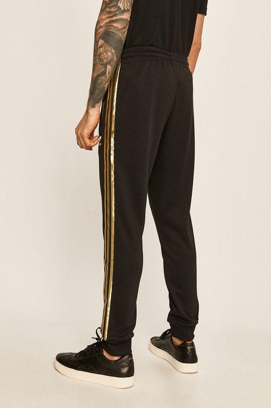 adidas Originals - Kalhoty Hlavní materiál: 100% Recyklovaný polyester Stahovák: 100% Polyester