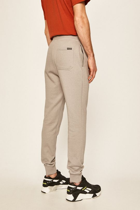 Columbia - Pantaloni  Materialul de baza: 80% Bumbac, 20% Poliester  Banda elastica: 58% Bumbac, 4% Elastan, 38% Poliester