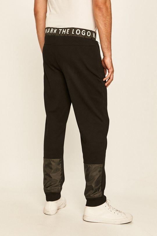 Guess Jeans - Kalhoty  Hlavní materiál: 100% Bavlna Jiné materiály: 100% Polyester