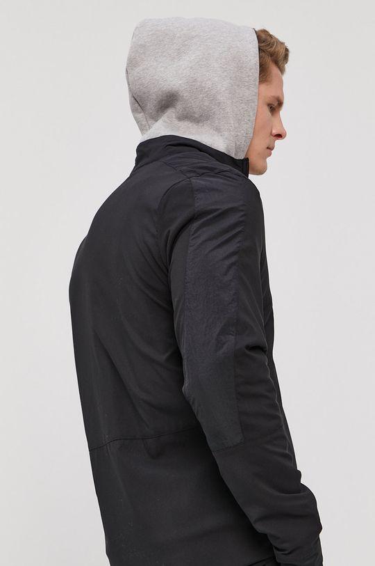 Reebok - Bunda  Vnitřek: 100% Nylon Hlavní materiál: 100% Recyklovaný polyester Stahovák: 9% Elastan, 91% Recyklovaný polyester