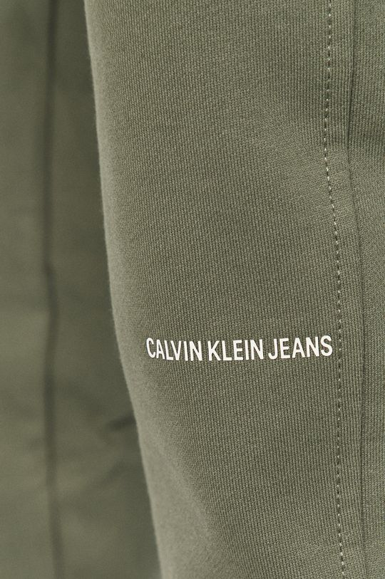 hnedozelená Calvin Klein Jeans - Nohavice