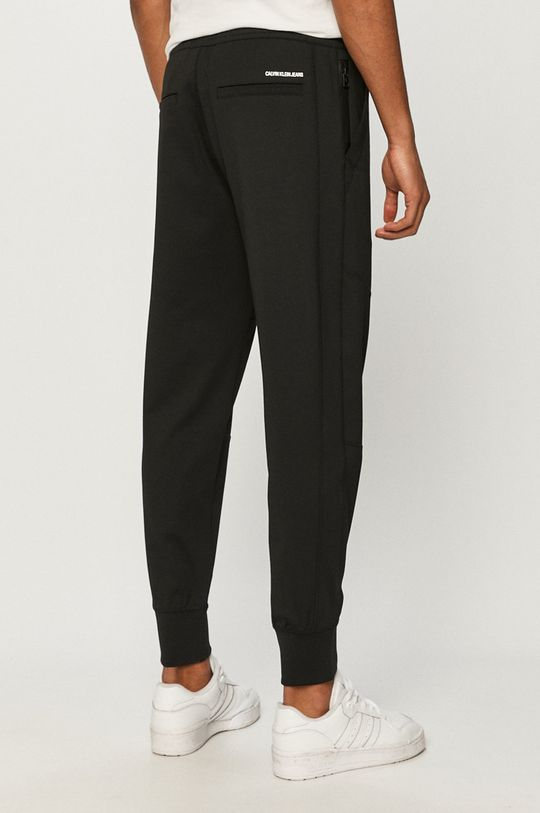 Calvin Klein Jeans - Spodnie 4 % Elastan, 77 % Poliester, 19 % Wiskoza