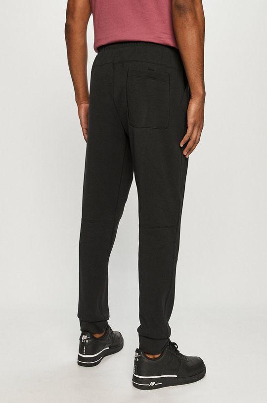 Nike Sportswear - Pantaloni  Materialul de baza: 71% Bumbac, 29% Poliester  Captuseala buzunarului: 100% Bumbac
