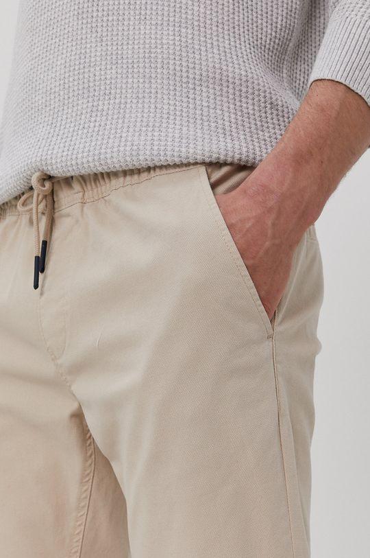 piaskowy Tommy Jeans - Spodnie