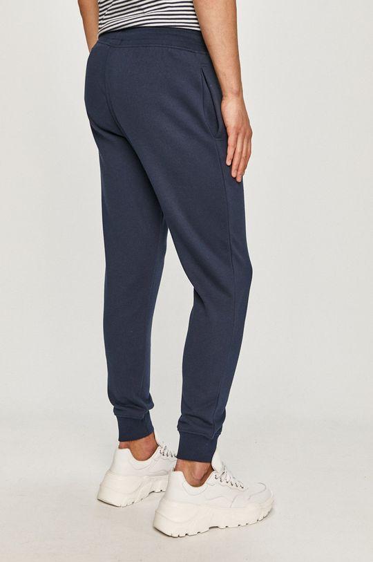 Tommy Jeans - Nohavice  Základná látka: 55% Organická bavlna, 45% Polyester Elastická manžeta: 95% Bavlna, 5% Elastan
