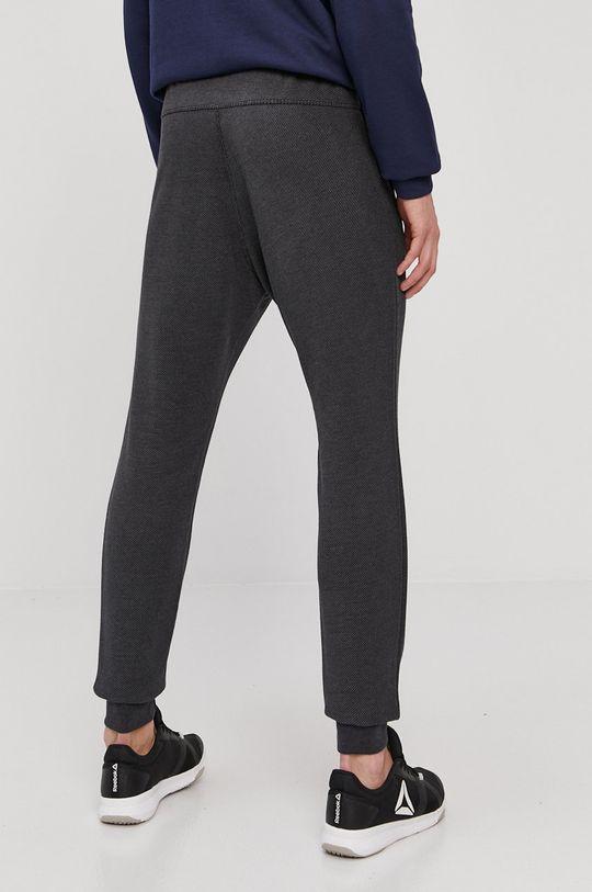 Reebok - Pantaloni  Captuseala: 100% Bumbac Materialul de baza: 65% Bumbac, 35% Poliester  Banda elastica: 52% Bumbac, 3% Elastan, 45% Poliester