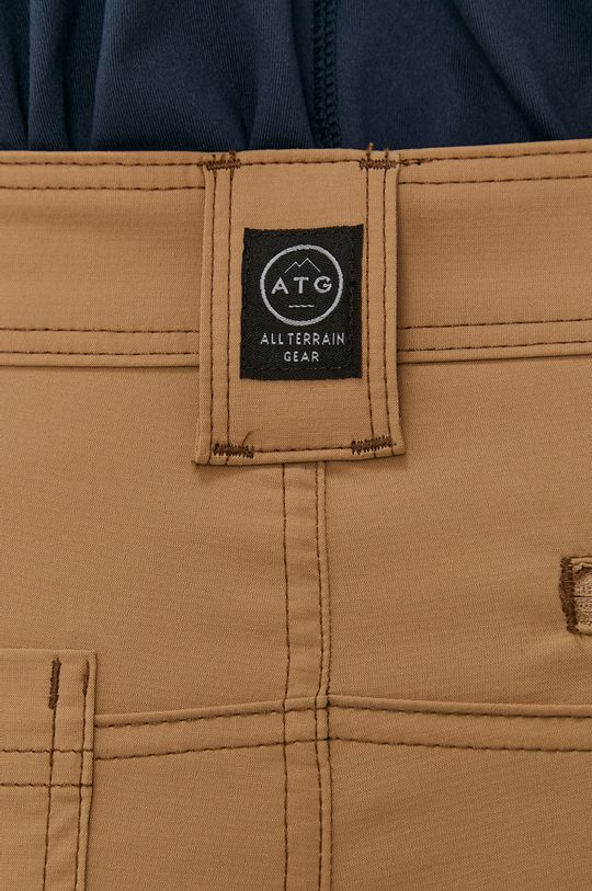 złoty brąz Wrangler - Spodnie ATG