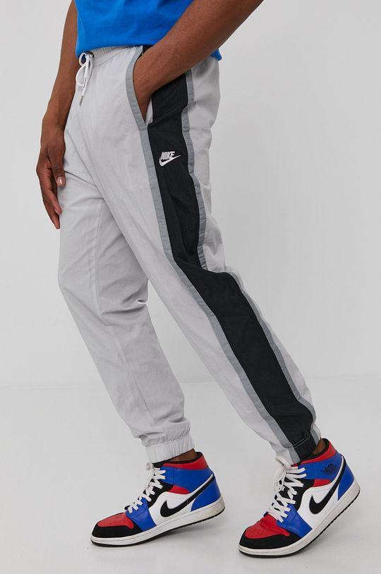 Nike Sportswear - Spodnie jasny szary