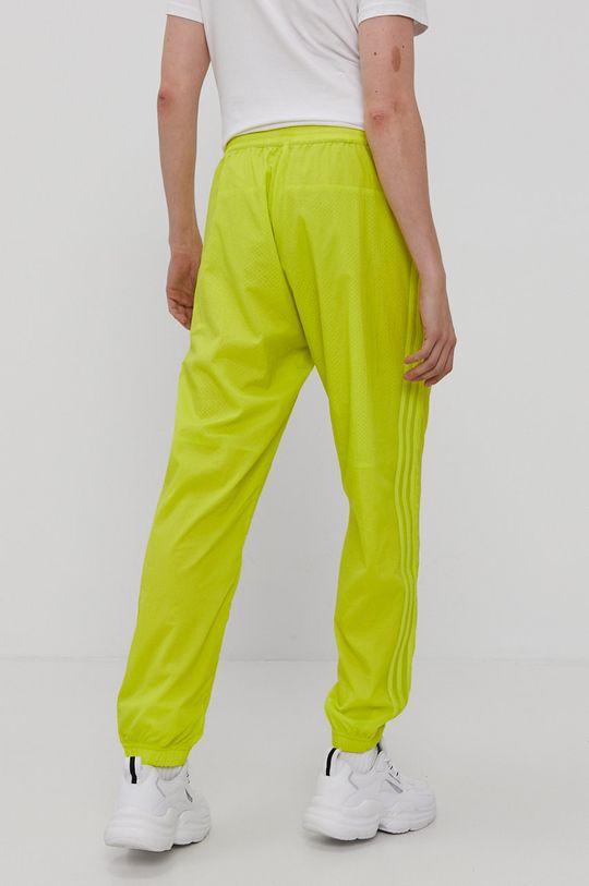żółty adidas Originals - Spodnie dwustronne