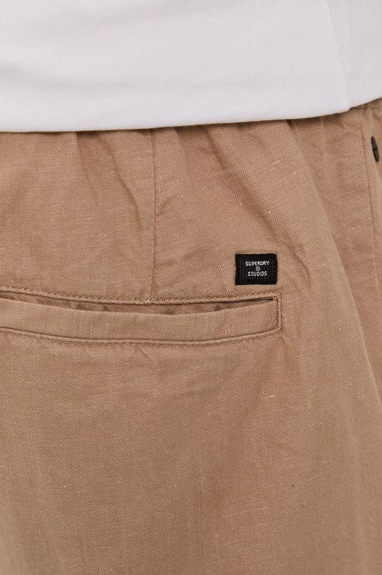 beżowy Superdry - Spodnie