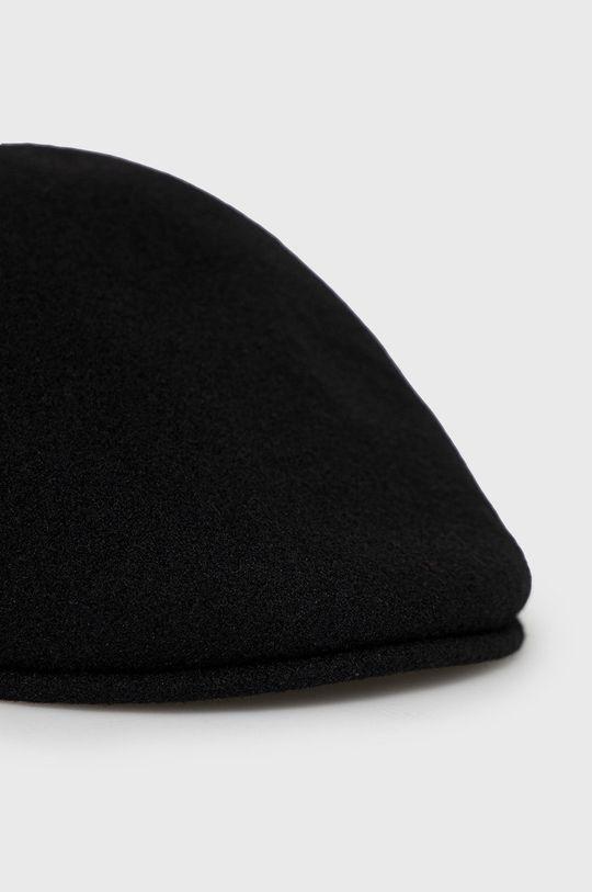 Kangol - Basca  Materialul de baza: 30% Acril, 70% Lana Banda: 100% Nailon